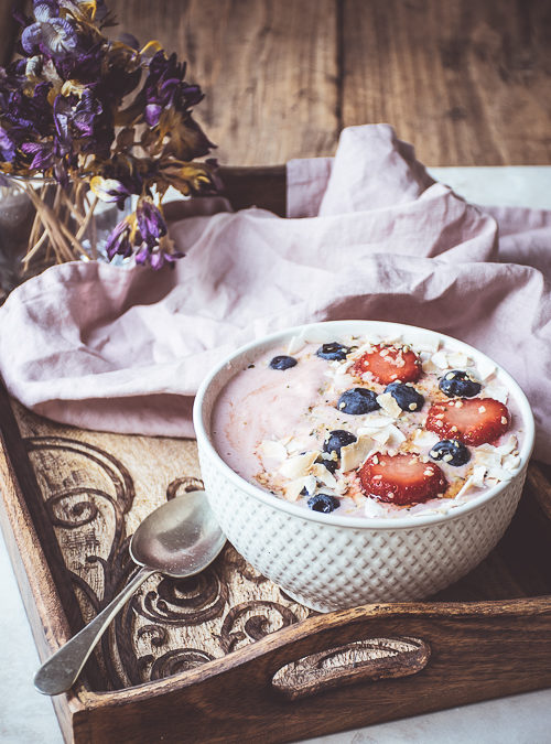 Creamed Strawberry Oats topped with Berries & Hemp Hearts