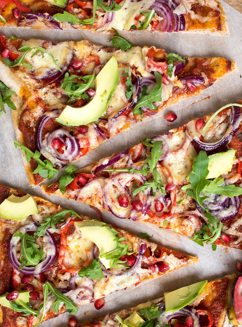 Instant Pizza Dough topped with avocado, pomegranate & red onion