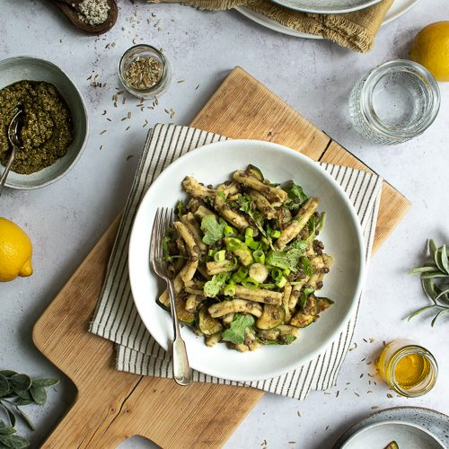 Pasta with green basil pesto, courgette, rocket and spinach and green lentils