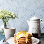 wholemeal spelt pancakes topped with vanilla soy yoghurt and passion fruit
