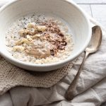 Oats with tahini, shelled hemp, cashews, chia and chocolate