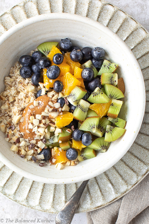 Oats, Chopped Brazils, Almond Butter, Orange, Kiwi & Blueberries